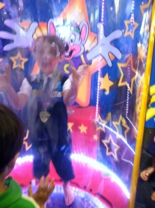 My kid at Chuck E Cheese having a great time at his birthday.  Also TICKETS!!!!!!